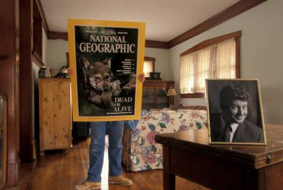 Photo: Photographer Joel Sartore holds up an enlarged NGM cover in his living room in Lincoln, NE.