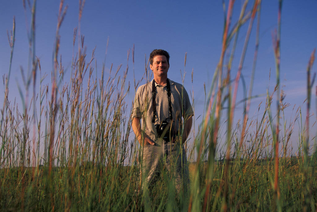 Photo: Photographer Joel Sartore on the prairie.