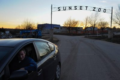 Photo: Joel Sartore drives away from the Sunset Zoo...at sunset, of course.