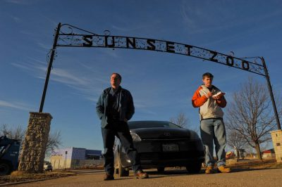Photo: During a portrait with his dad, Cole Sartore (right) eats his breakfast of French toast sticks from Burger King at the Sunset Zoo.