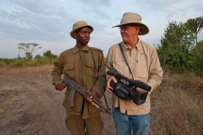 Photo: A videographer poses with a park ranger in Queen Elizabeth National Park in Uganda.