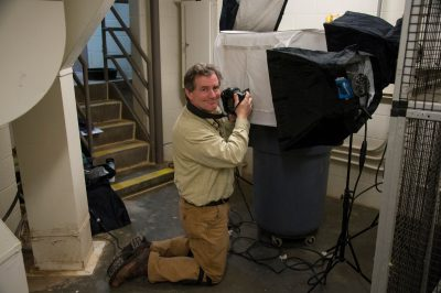 Photo: Joel Sartore photographs birds at a zoo.