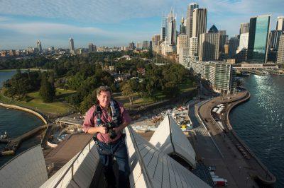 Photo: Joel Sartore at the top of the Sydney Opera House, Australia.