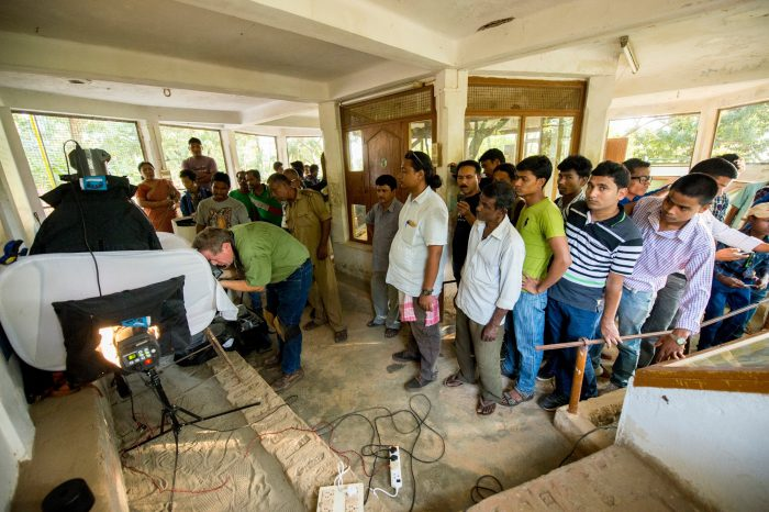 Photo: A crowd gathers to watch the Photo Ark shoot inside the reptile house at the Assam State Zoo in Guwahati, Assam, India.