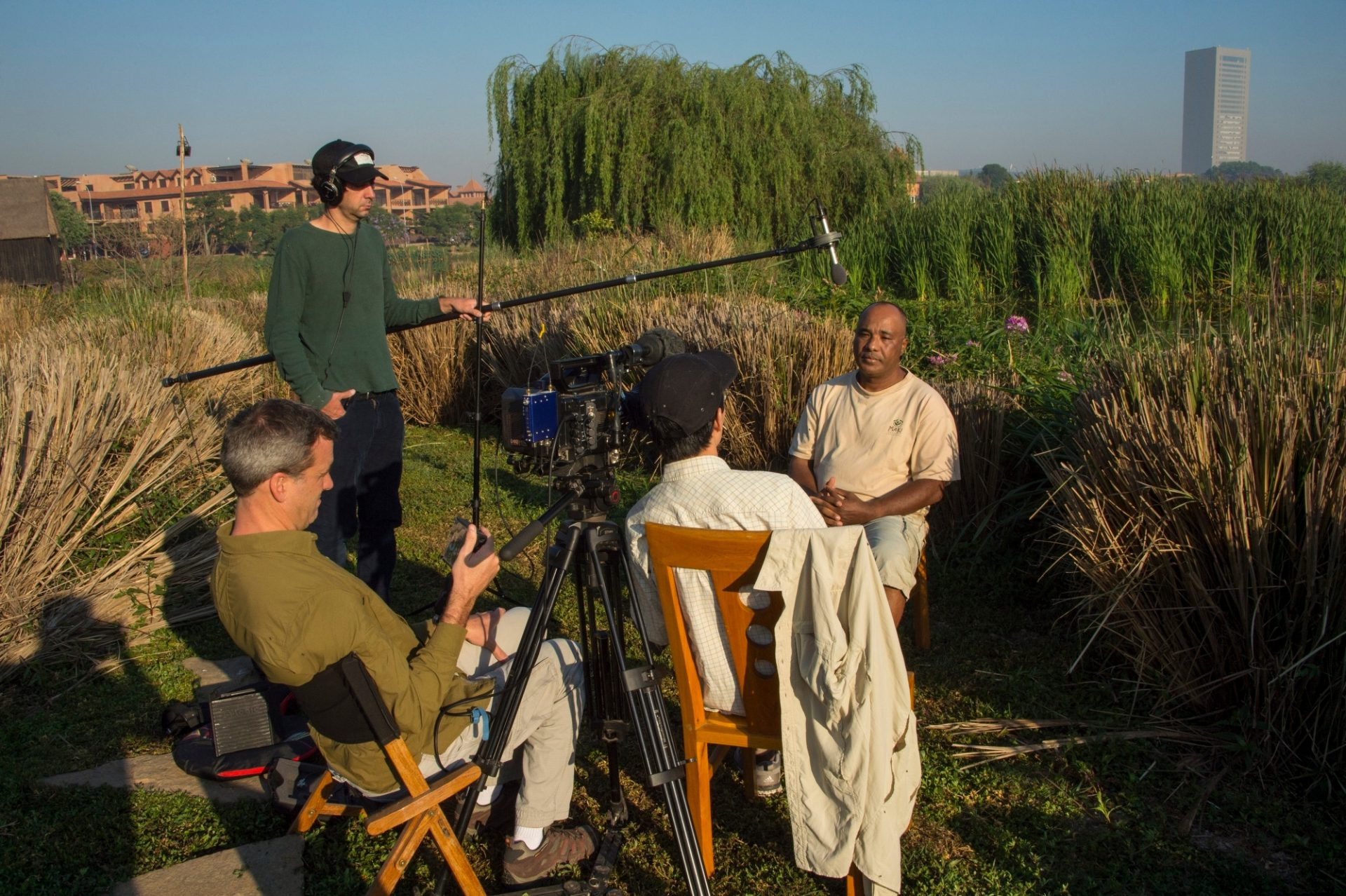 Photo: A television crew interviews Lily Rene de Roland Arison, who rediscovered the once thought extinct Madagascar pochard.