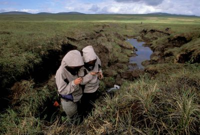 Photo: Scientists from the Toolik Research Station examine a thermokarst on Alaska's North Slope.