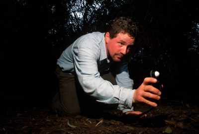 Photo: Joel Sartore checks the exposure setting on a camera trap in Brazil's Pantanal.