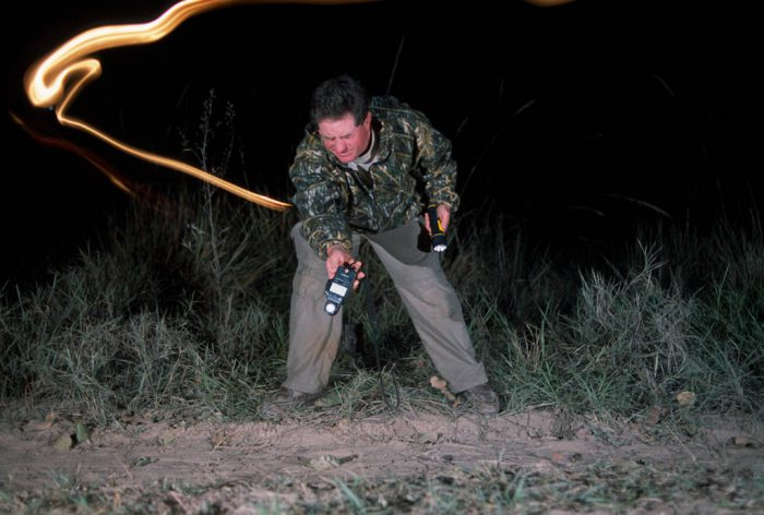 Photo: Testing a camera trap on assignment in Brazil's Pantanal.