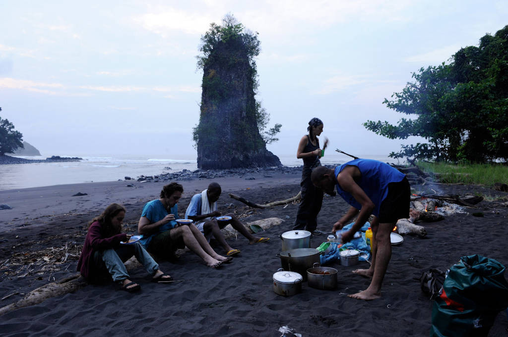 Photo: Expedition members prepare a fire in order to prepare meals along the coast of Bioko Island, Equitorial Guinea.