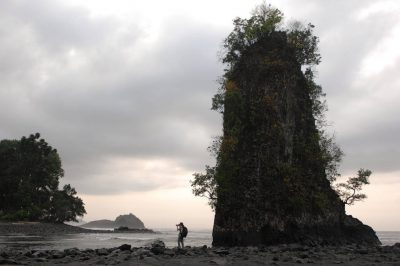 Photo: An expedition member takes photographs along the coast of Bioko Island, Equitorial Guinea.