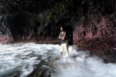 Photo: An expedition guide standing in a coastal cave along Bioko Island, Equatorial Guinea.
