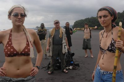 Photo: Joel Sartore stands on a beach on Bioko Island, Equatorial Guinea with expedition members and guides.