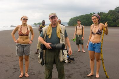 Photo: Joel Sartore stands on a beach on Bioko Island, Equitorial Guinea with expedition members and guides.