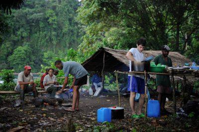 Photo: Expedition members prepare dinner at the campsite on Bioko Island, Equatorial Guinea.