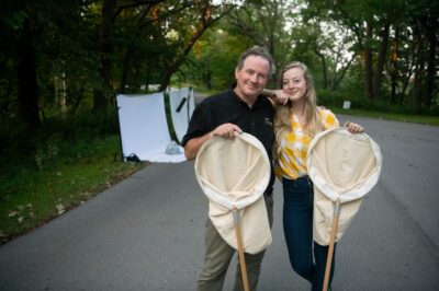 Photo: Joel Sartore and daughter, Ellen Sartore, document insects at Indian Cave State Park in Nebraska.
