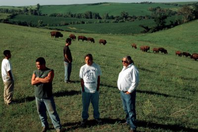 Photo: Louis LaRose and youth from the Winnebago tribe with the tribal bison herd near Winnebago, Nebraska.