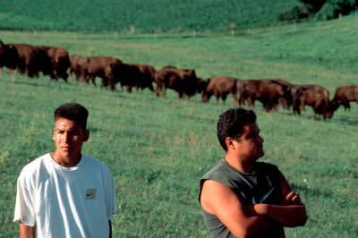 Photo: Youth from the Winnebago tribe with the tribal bison herd near Winnebago, Nebraska.