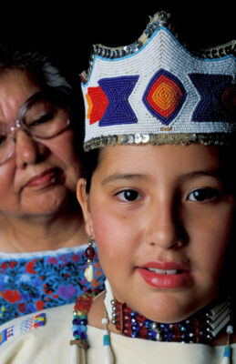 Photo: Grandmother and granddaughter, both members of the Ponca tribe (names available upon request) sit for a portrait in traditional regalia before a pow wow in White Eagle, OK.
