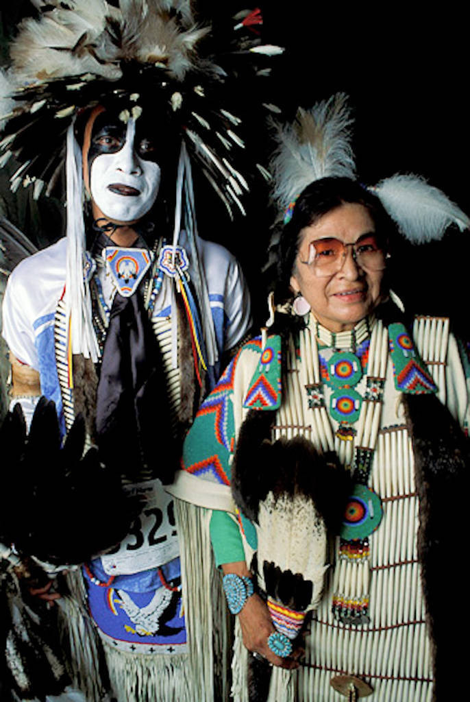 Photo: Dancers (names available upon request) pose for a portrait in traditional regalia at the Cherokee National Holiday in Tahlequah, OK.