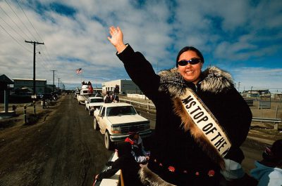 Photo: Miss Top of the World waves to the crowd during the July 4th celebration in Barrow, the North Slope's largest village.