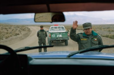 Photo: Police, seen through the windshield of a truck, stop visitors speeding in Chile's Atacama desert.