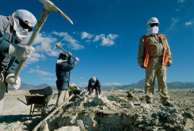 Photo: Miners masked against sun and cold carve up the land in search of borax in Chile's Atacama desert.