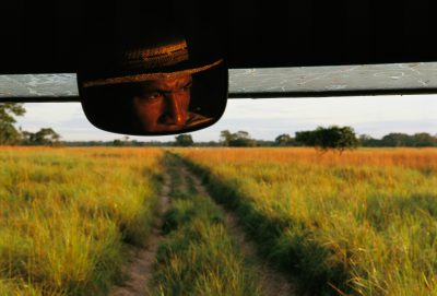 Photo: Wildlife spotter and guide in the rear-view mirror of his vehicle on the Rio Negro ranch in Brazil.
