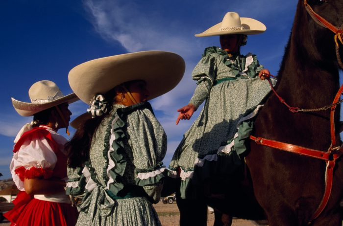 Photo: Members of the Escaramuza Espuelas de Oro, the Golden Spur Equestrian drill team, are dressed in traditional Mexican dress at a festival in El Paso, Texas.