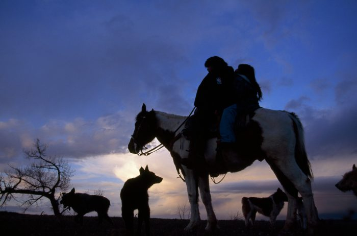 Photo: Two Ute Indian girls on a horse at sunset in Ouray, Utah.