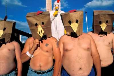 """Photo: Members of a Wayne State College fraternity are transformed into the """"Chickendale"""" Dancers at the Wayne Chicken festival in Nebraska."""