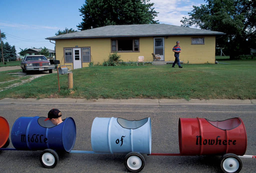 """Photo: Children ride in a parade as part of the """"Middle of Nowhere"""" Festival in Ainsworth, Nebraska."""