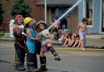 Photo: Young kids use a fire hose in Peru, Nebraska.