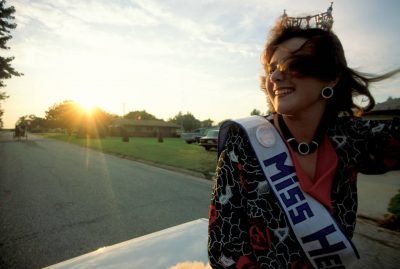Photo: Miss Heartland is driven in a parade in the Harper County Fair in Harper, Kansas.