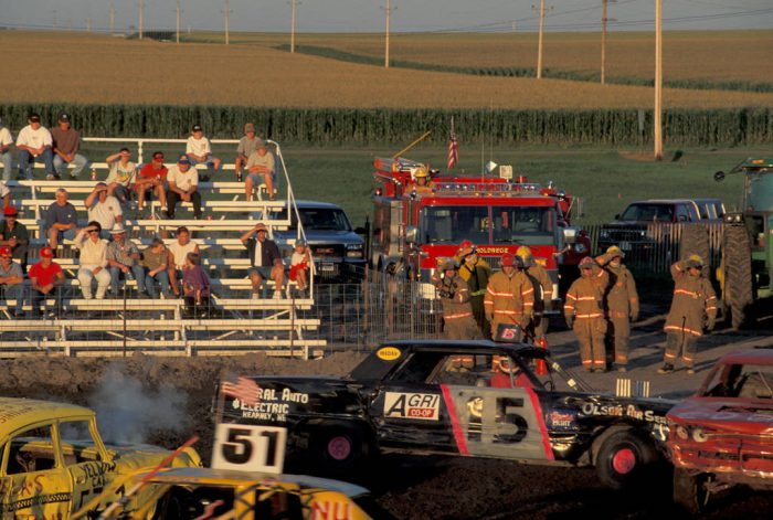 Photo: Firefighters stand by at the Phelps County (NE) Fair's demolition derby in Holdrege, Nebraska.