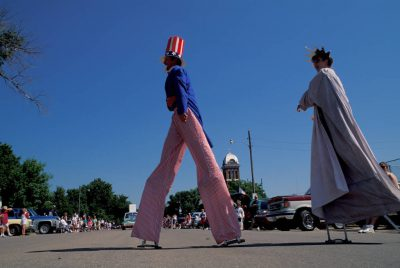 Photo: A man and his daughter play the roles of Uncle Sam and the Statue of Liberty in Stuart, Nebraska's Fourth of July Parade.