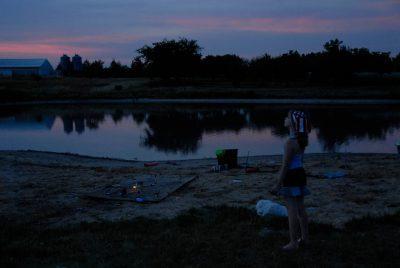 Photo: Ellen Sartore watches a fireworks display at a Fourth of July celebration in Greenleaf, KS.