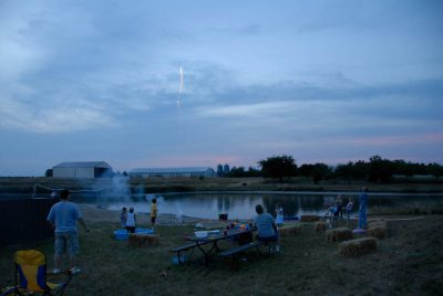 Photo: A family celebrates the Fourth of July with a picnic and fireworks near Greenleaf, KS.