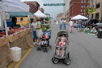 Photo: Two women and their babies shop at the Farmer's market in Lincoln's historic Haymarket district.