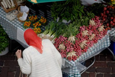 Photo: A woman shops at the Farmer's market in Lincoln's historic Haymarket district.