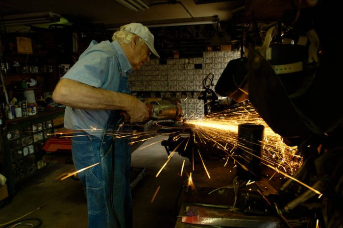 Photo: Sparks fly as a man uses a grinder on his Nebraska farm.