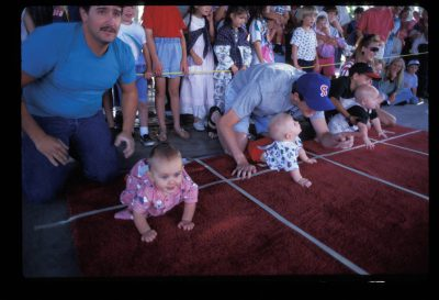"Photo: A ""diaper derby"" is held in a town park in Richfield, Utah."
