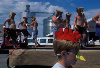 """Photo: Members of a Wayne State College fraternity are transformedinto the """"Chickendale"""" Dancers at the Wayne Chicken festival in Nebraska."""