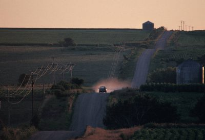Photo: A truck drives down a gravel road in rural Nebraska.