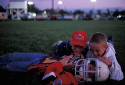 Photo: Young boys clown around after a high school football game in Bradshaw, Nebraska.