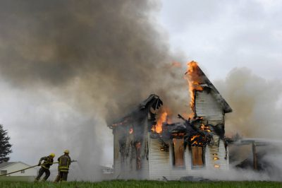 Photo: Local firefighters from the Palmyra Fire Department practiced their technique on a controlled house burn.