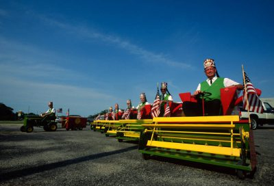 Photo: At the Harper County Fair in Harper, Kansas, a group of Shriners drive mini combines.
