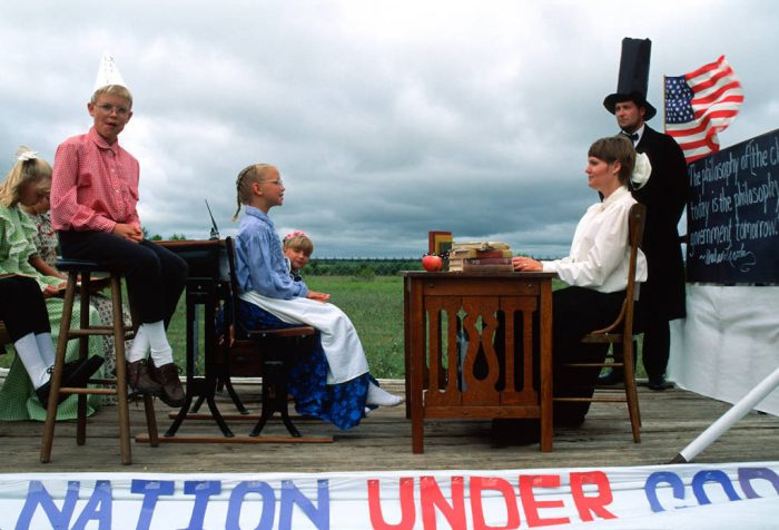 Photo: A parade float at the Old Settler's Picnic in Western, Nebraska re-enacts a one-room school house under the watchful eye of an Abraham Lincoln impersonator.