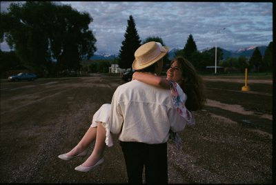 Photo: A young man carries his girlfriend away after graduating from high school in Salmon, Idaho.