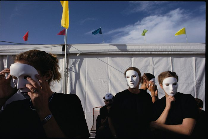 Photo: A group of masked waiters tend a summer wine auction in Sun Valley, Idaho.
