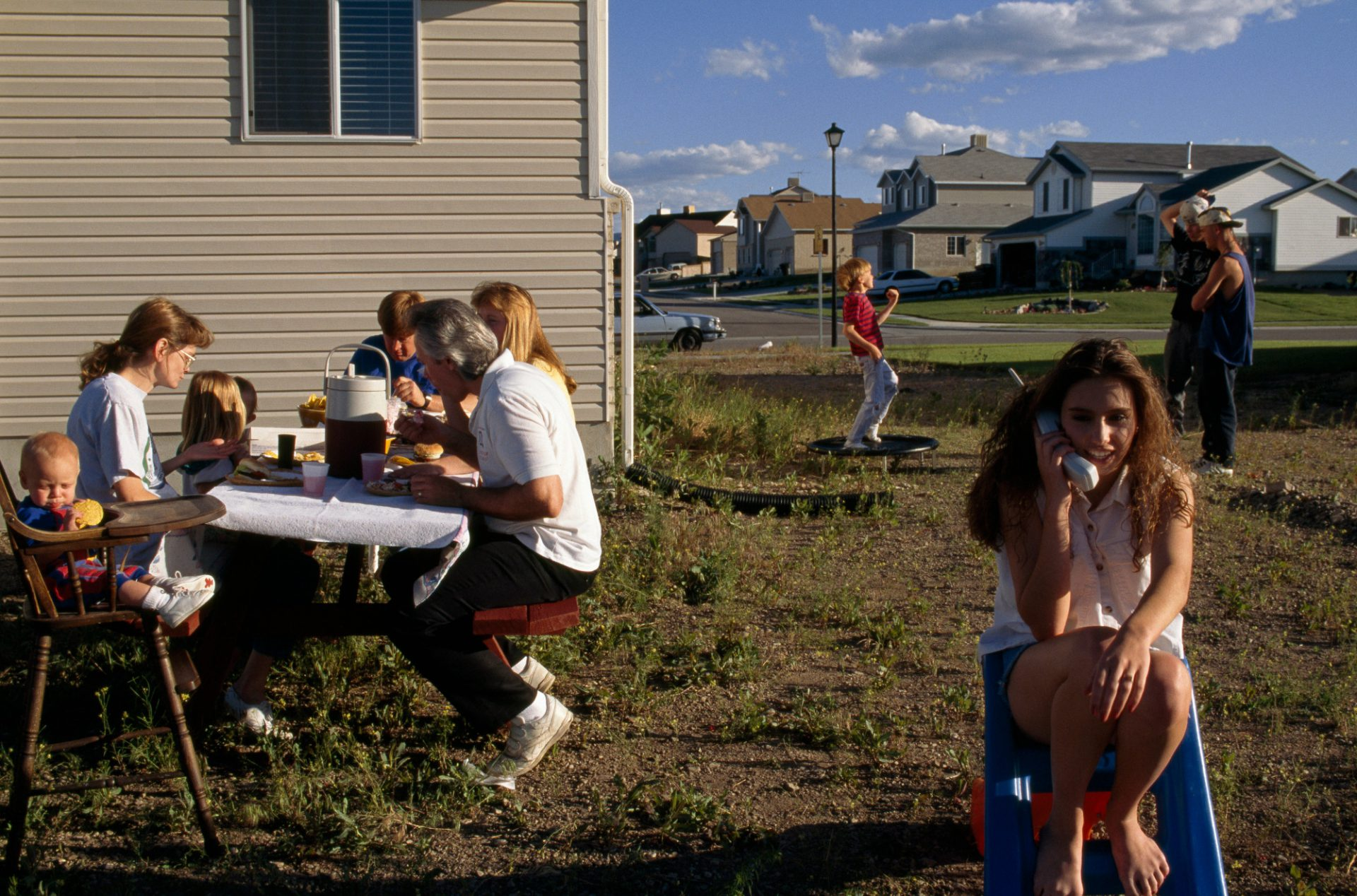 Photo: A family picnic outside their suburban house in West Jordan, a suburb of Salt Lake City, Utah.